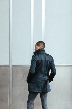 Matilda Delves Young man in black coat