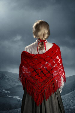 Magdalena Russocka historical woman with red shawl standing in countryside with lake