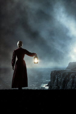 Magdalena Russocka historical woman with lantern standing be sea at night