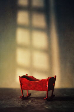 Magdalena Russocka red cradle with shadow of window inside