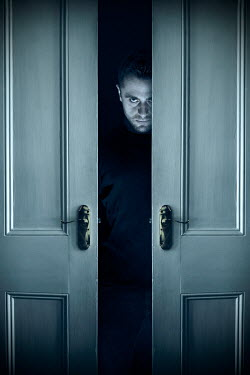 Miguel Sobreira Sinister man behind doors