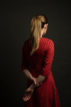 Miguel Sobreira Young woman with ponytail and 1950s polka dot dress