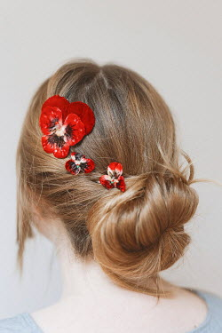 Shelley Richmond Young woman with hair bun and red flowers