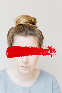 Shelley Richmond Young woman with hair bun with red paint