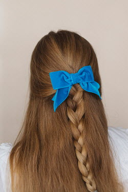 Shelley Richmond Young woman with braided hair and blue ribbon