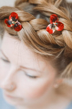 Shelley Richmond Young woman with red flowers in braided hair