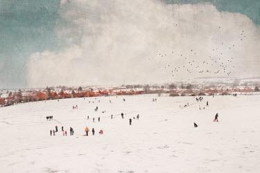 Anna Buczek People walking in snow on field