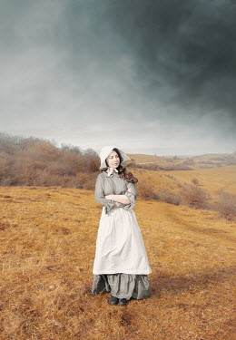 Anna Buczek Victorian maid in uniform standing on hill