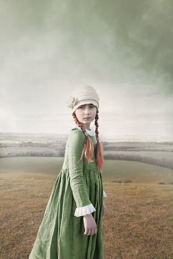 Anna Buczek Victorian girl in green dress standing in field