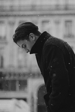 Anna Rakhvalova SERIOUS YOUNG MAN OUTDOORS IN CITY WITH SNOW Men