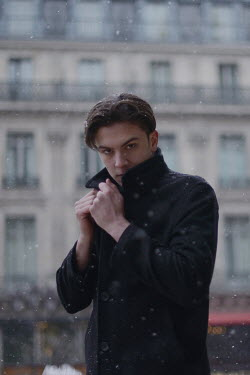 Anna Rakhvalova YOUNG MAN OUTDOORS IN CITY WITH SNOW Men