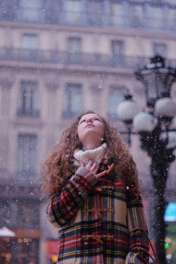Anna Rakhvalova WOMAN WITH RED HAIR STANDING IN CITY WITH SNOW Women