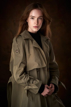 Alexander Vinogradov SERIOUS YOUNG BRUNETTE GIRL IN RAINCOAT Women