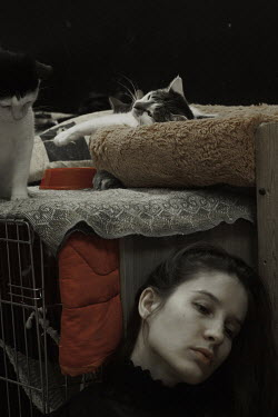 Daria Amaranth SAD WOMAN SITTING WITH CATS ON CAGE Women