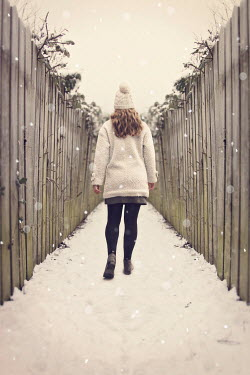Emma Goulder BLONDE WOMAN WALKING IN SNOWY ALLEYWAY Women