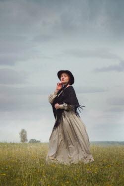 Joanna Czogala HISTORICAL WOMAN IN HAT STANDING IN COUNTRYSIDE Women