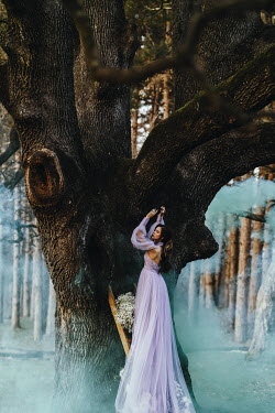 Jovana Rikalo WOMAN IN GOWN WITH FLOWERS AND TREE HOUSE Women