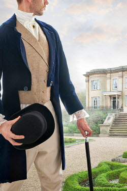 Lee Avison regency man in the grounds of a mansion looking back