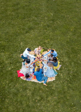 Mary Wethey FAMILIES AND FRIENDS WITH PICNIC DRINKING OUTDOORS Groups/Crowds