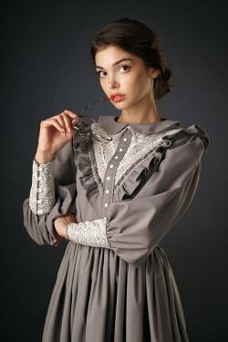 Alexander Vinogradov BRUNETTE WOMAN IN LACY DRESS HOLDING GLASSES Women