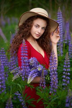 Alexander Vinogradov WOMAN IN HAT PICKING FLOWERS IN GARDEN Women
