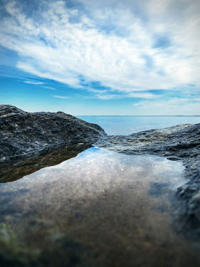 Lisa Bonowicz ROCK POOL WITH SEA AND BLUE SKY Seascapes/Beaches