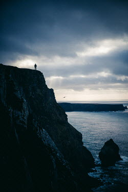 Marie Carr DISTANT MAN STANDING ON CLIFF BY SEA Men