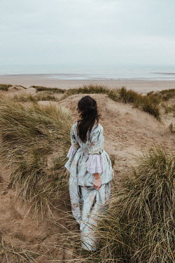 Matilda Delves HISTORICAL WOMAN STANDING IN SAND DUNES Women