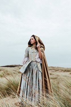 Matilda Delves HISTORICAL WOMAN WITH CAPE STANDING IN SAND DUNES Women