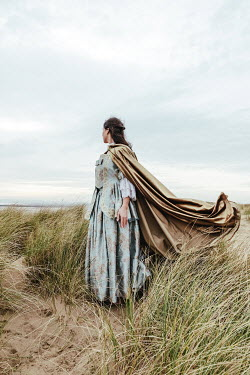Matilda Delves HISTORICAL WOMAN WITH CAPE IN DUNES WATCHING SEA