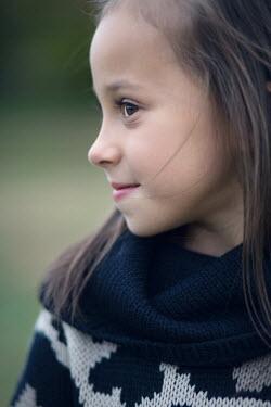 Susan Fox SMILING LITTLE GIRL WITH DARK HAIR OUTDOORS Children