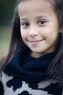 Susan Fox SMILING LITTLE GIRL WITH DARK HAIR OUTDOORS