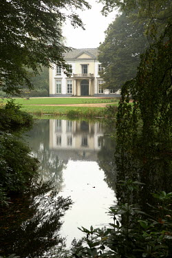 Yolande de Kort LARGE HOUSE WITH LAKE AND TREES