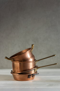 Paolo Martinez STACK OF COPPER SAUCEPANS