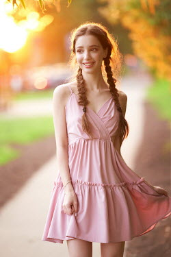 Alexander Vinogradov SMILING GIRL WITH PLAITS OUTDOORS IN SUNLIGHT