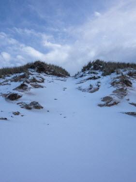 David Baker EMPTY SAND DUNES IN SNOW