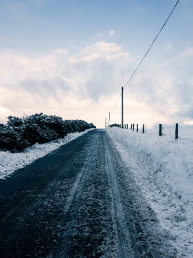 David Baker EMPTY COUNTRY ROAD WITH SNOW Paths/Tracks