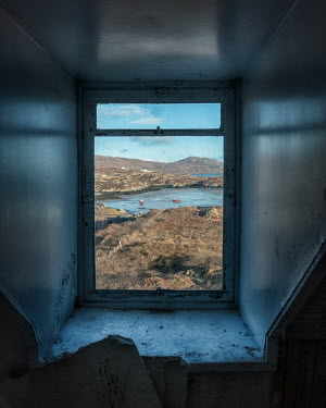 David Baker DERELICT COTTAGE WINDOW WITH VIEW OF COASTLINE