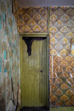David Baker INTERIOR COTTAGE DOOR WITH PEELING WALLPAPER