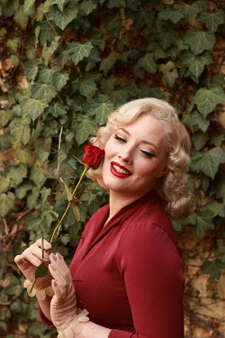 Jasenka Arbanas RETRO BLONDE WOMAN HOLDING ROSE OUTDOORS