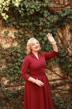 Jasenka Arbanas HAPPY BLONDE RETRO WOMAN WAVING OUTDOORS