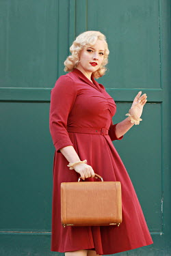 Jasenka Arbanas BLONDE RETRO WOMAN WAVING AND CARRYING CASE
