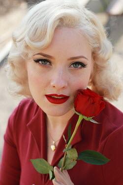 Jasenka Arbanas RETRO BLONDE WOMAN HOLDING ROSE OUTDOORS