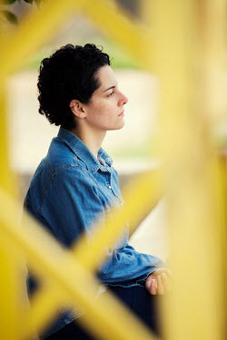 Mohamad Itani THOUGHTFUL WOMAN WITH SHORT HAIR SITTING OUTDOORS