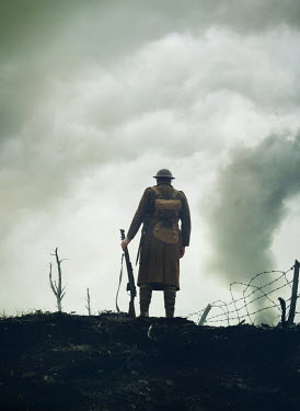 Mark Owen WW1 SOLDIER OUTDOORS WITH SMOKE AND BARBED WIRE