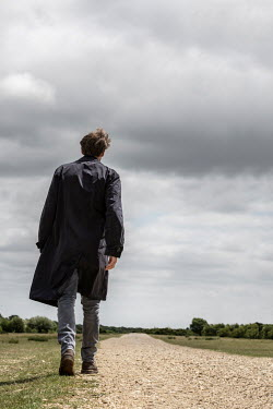 CollaborationJS MAN IN RAINCOAT WALKING ON COUNTRY PATH