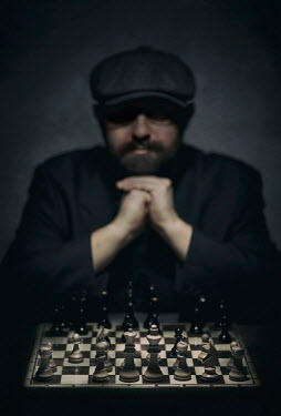Jaroslaw Blaminsky MAN IN CAP SITTING WITH CHESS BOARD
