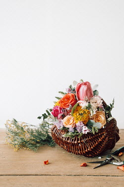Magdalena Wasiczek FLOWER ARRANGEMENT IN BASKET WITH SCISSORS