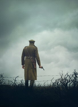 Mark Owen SOLDIER WITH GUN IN FIELD WITH BARBED WIRE