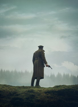 Mark Owen SOLDIER WITH GUN IN COUNTRYSIDE WITH FOREST
